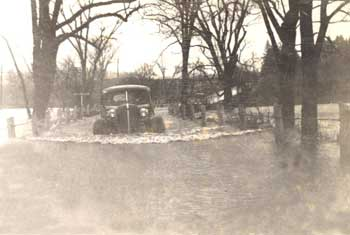 Flood with car, 1936. Woodstock Historical Society photo
